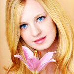 portrait of a young beautiful blonde girl with flower